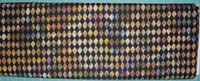 Patchworkstoff Stoff Quilt Batik Rhomben, Rauten auf schwarz