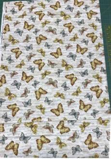 Patchworkstoff Quilt Stoff Papillon Schmetterlinge und Schriftverzierung im Hintergrund