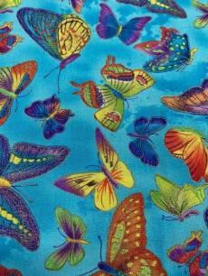 Patchworkstoff *Flutter* Schmetterlinge mit Glitzer auf blau