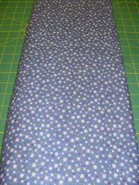 Patchworkstoff Stoff Quilt Schneeflocken mit bunten Punkten auf blau 30x110cm